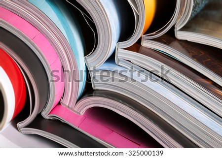 Close-up of stack of colorful magazines. Press, news and magazines concept - stock photo
