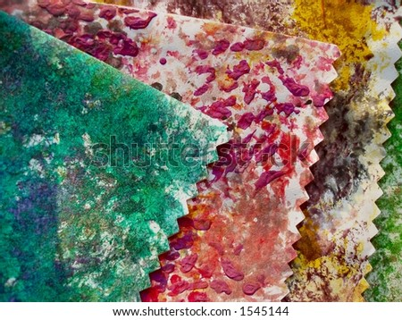 Close-up of stack of colourful handmade paper with jagged edges