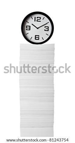 close up of stack of papers and clock on white background - stock photo