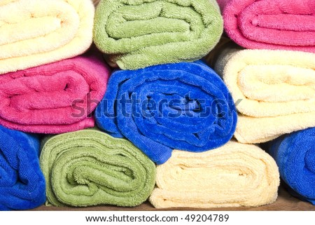 Close up of stacked bright colourful towels