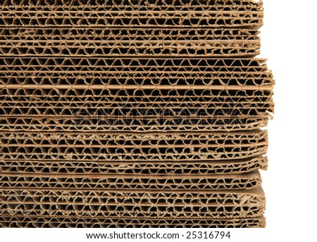 Close-up of stacked corrugated cardboard on white background. - stock photo