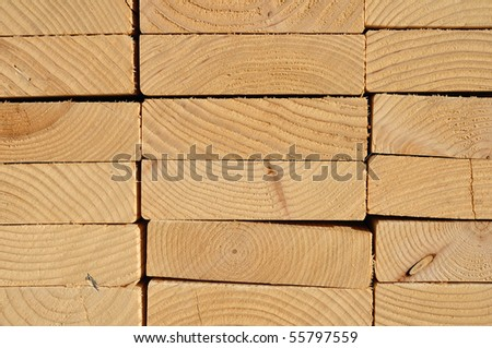 Close-up of Stacked Lumber for construction, background - stock photo