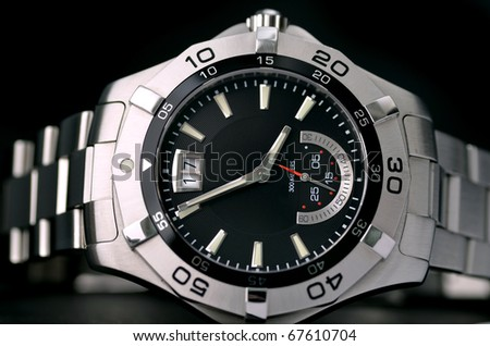 Close up of stainless wristwatch - stock photo