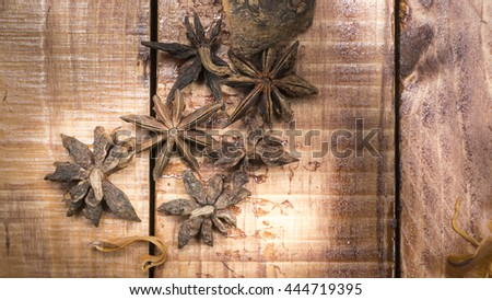 Close-up of star anise on a wooden table  - stock photo
