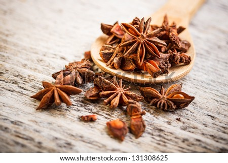 Close up of star anise on wooden board - stock photo