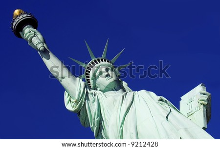 Close-up of Statue of Liberty against a bright blue sky. - stock photo