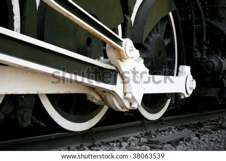 close up of steam engine locomotive wheels - stock photo