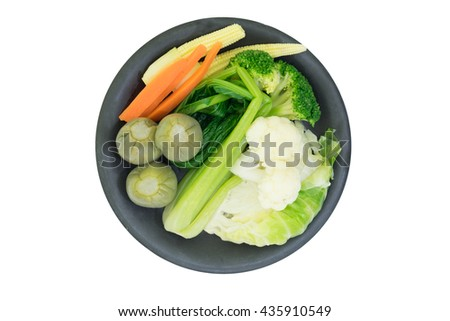 Close up of steamed vegetables on isolated background - stock photo