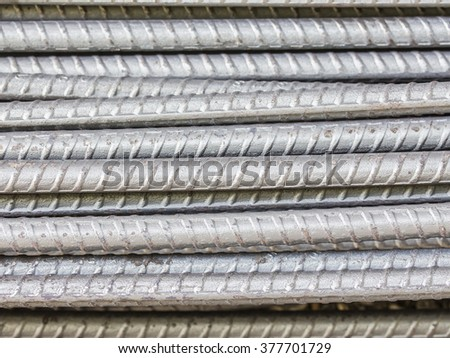 close up of Steel rods or bars used to reinforce concrete for construction, preparing to build a house - stock photo