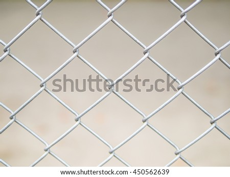 Close up of steel wire mesh fence background - stock photo