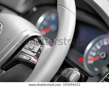 Close up of steering wheel commands in modern luxurious car - stock photo