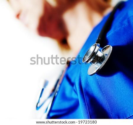 Close up of stethoscop around nurse's neck. - stock photo