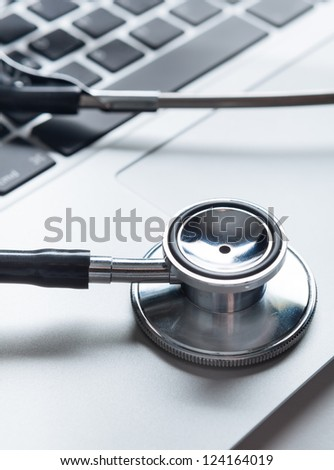 Close up of stethoscope on computer keyboard. Healthcare concept - stock photo