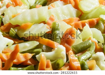 Close-up of stir-fry vegetables -- carrots, sayote, string beans - stock photo