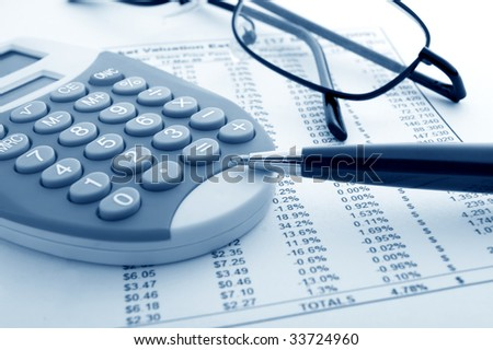 close up of stock market numbers and fountain pen - stock photo
