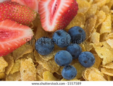 Close up of strawberries and blueberries with cereal - stock photo