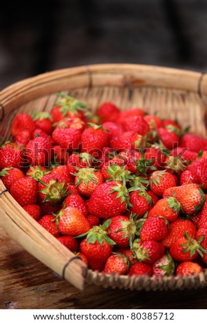 Close up of Strawberries in Basket on a wooden table - stock photo