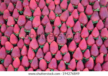close up of strawberry on market stand - stock photo