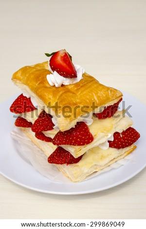 Close-up of Strawberry pastry with vanilla cream - stock photo