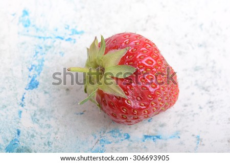 Close up of strawberry with green leaves - stock photo