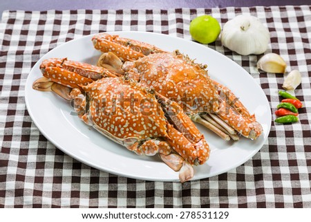 Close up of streamed blue crabs ( sand crab ) and herb - stock photo