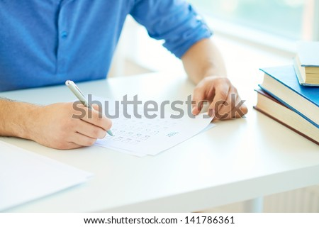 Close-up of student carrying out test at lesson - stock photo