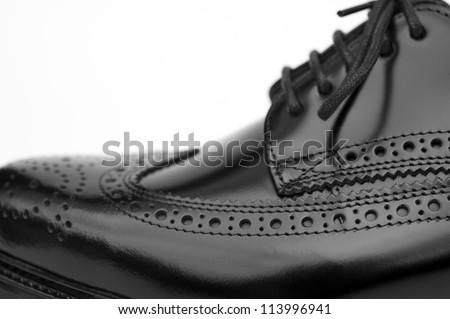 Close up of stylish black brogue shoe - stock photo