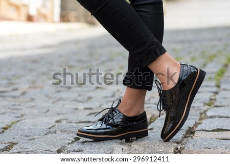 Close up of stylish female shoes.  Outdoor fashion shoes footwear concept. - stock photo