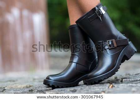 Close up of stylish female shoes.  Outdoor fashion shoes footwear concept. Fashionable boots.