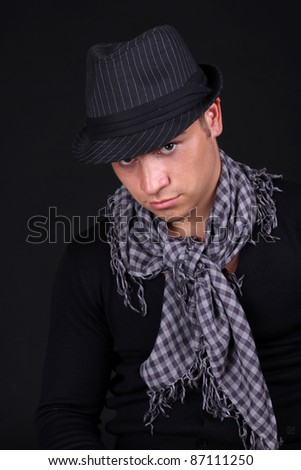 Close up of stylish man in classic hat isolated black background