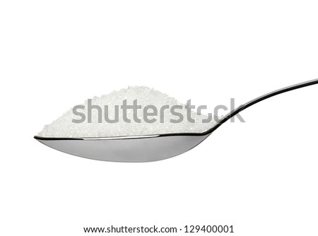 close up of  sugar cubes in a spoon on white background with clipping path - stock photo