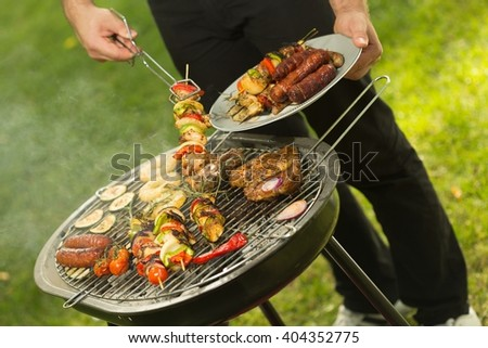 Close-up of summer barbecue in the garden - stock photo