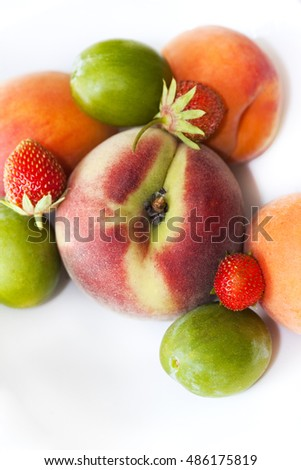 Close up of summer fruits on a white table