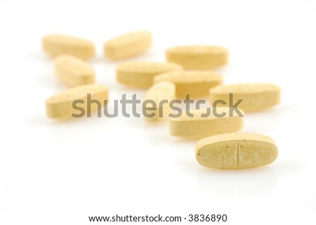 Close up of supplement vitamin pills in isolated white background