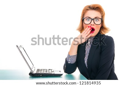 Close-up of surprised business woman with laptop, isolated on white - stock photo