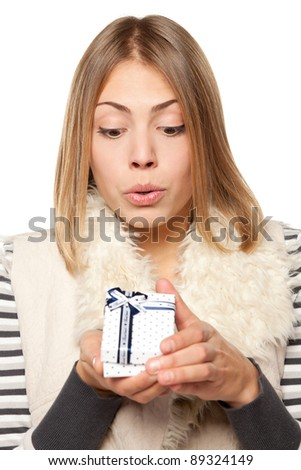 Close up of surprised girl opening the gift box over white background - stock photo