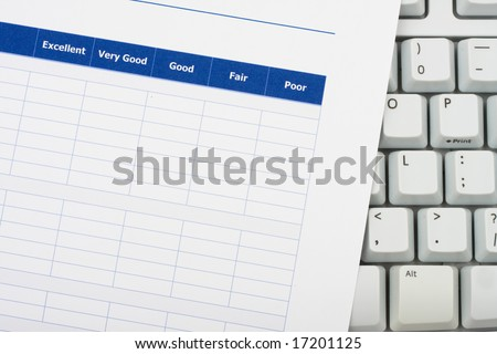 Close up of survey with computer keyboard, excellent customer service - stock photo