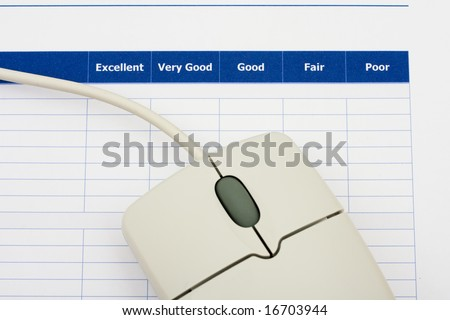 Close up of survey with computer mouse, excellent customer service - stock photo