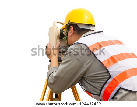 close-up of Surveyor engineer making measure - stock photo