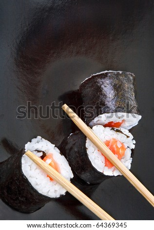 close-up of sushi and chopsticks