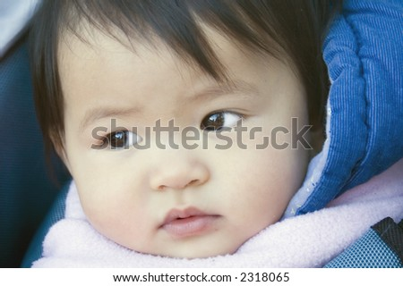 close up of sweet asian baby girl - stock photo