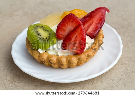 Close up of sweet cake with fruits - stock photo