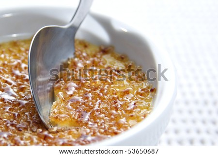 close up of sweet creme brulee with crunchy caramelized sugar on top - stock photo