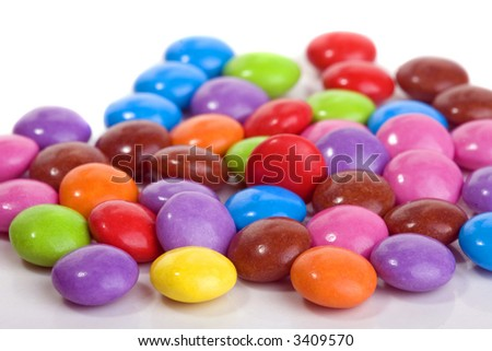 close up of sweet smarties on white background - stock photo