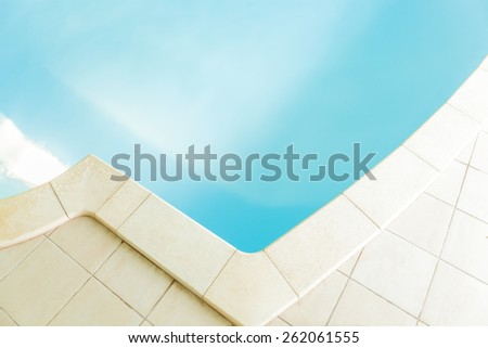 Close-up of swimming pool with marble tiles - stock photo