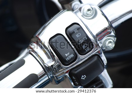 Close-up of switches on a motorcycle handlebar - stock photo
