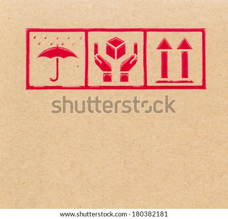 Close-up of symbols on cardboard box. - stock photo