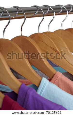 close up of t shirts on cloth hangers in row - stock photo