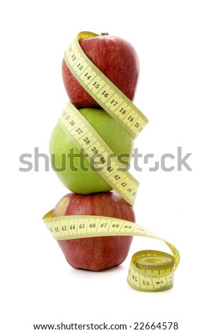 close up of tailors centimeter and apple on white background with clipping path - stock photo