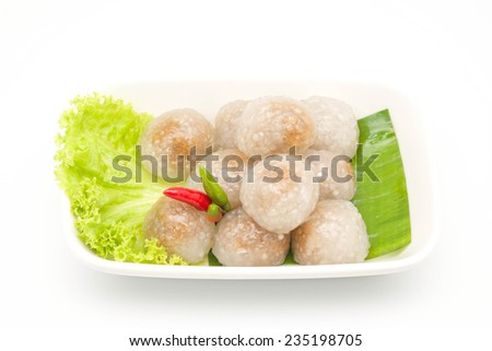 Close up of tapioca pork for Thai dessert or snack with chili on ceramic plate with white background - stock photo